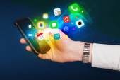 Hand holding smartphone with colorful app icons — Stock Photo