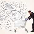 Businessman with shopping cart — Stock Photo #70392251