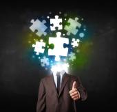 Character in suit with puzzle head concept — Stock Photo