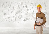 Construction worker planing with hand drawn tool icons — Stock Photo