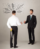Angry business handshake concept — Stock Photo