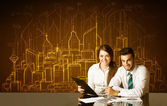 Business couple with buildings and numbers — Stock Photo