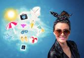 Happy joyful woman with sunglasses looking at summer icons  — Stock Photo