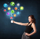 Businesswoman holding a white cup with setting icons — Stock Photo