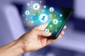 Finger pointing on smartphone, social network concept — Stock Photo