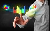 Handsome young business man touching colorful modern graph syste — Stock Photo