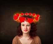 Teenager girl with heart illustrations circleing around her head — Stock Photo