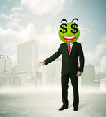 Man with dollar sign smiley face — Stock Photo