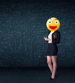 Businesswoman wears yellow smiley face — Stock Photo