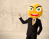 Businessman with smiley face — Stock Photo