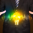 Businessman holding light bulb — Stock Photo #71663461