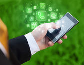 Hand holding smartphone with mobile app icons — Stock Photo