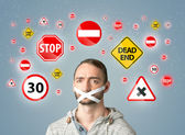 Young man with glued mouth and traffic signals — Stock Photo