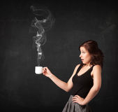 Businesswoman holding a white steamy cup — Stock Photo