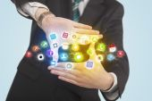 Hands creating a form with mobile app icons — Stock Photo
