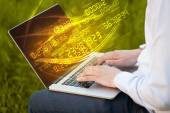 Man typing on modern notebook with number technology data coming — Stock Photo