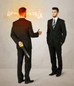Angry businessman with weapon — Stock Photo