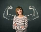 Woman with sketched strong and muscled arms — Stock Photo