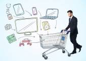 Businessman with shopping cart — Stock Photo