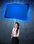 Businesswoman with shining tablet — Stock Photo