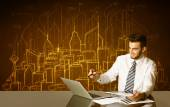 Businessman with buildings and numbers — Stock Photo