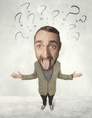 Big head person with question marks — Stock Photo