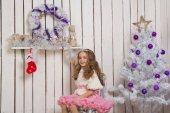 Little girl over fir tree — Stock Photo