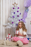 Little girl with christmas presents — Stock Photo