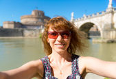 Selfie on the background of the Castel Sant Angelo in Rome — Stock Photo