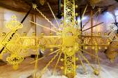 Reconstruction of a gilded cross on the top of church — Stock Photo