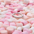 Wedding ring on pink and white mini marshmallows — Stock Photo #62013331