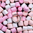Wedding ring on pink and white mini marshmallows — Stock Photo #62013339