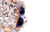 Sunglases and sea shells — Stock Photo