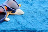 Sunglases and sea shells — Stock Photo