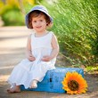 Happy child sitting outdoors in summer — Stock Photo #51812311