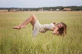Healthy woman floating in nature meadow — Stock Photo