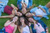 Group of teens fingers to lips for suprise secret.  — Stock Photo
