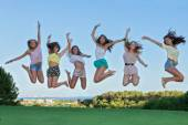 Group of happy teens jumping,  — Stock Photo