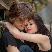 Young trendy couple hugging — Stock Photo
