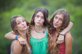Group of teens blowing kisses — Stock Photo