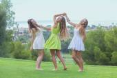 Dance outdoors healthy girls in summer — Stock Photo