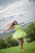 Carefree woman dancing in summer — Stock Photo