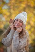 Happy smiling teeth in autumn — Stock Photo