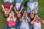 Group of kids shouting or singing — Stock Photo