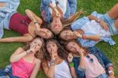Group teens fingers to lips — Stock Photo