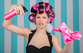 Retro woman in rollers multitasking — Stock Photo