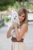 Loving pet owner holding dog — Stock Photo