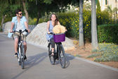People riding rental or hire bikes — Stock Photo