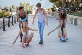 Group of kids on skateboards having summer fun — Stock Photo