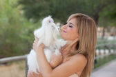 Maltese dogs with owners — Stock Photo